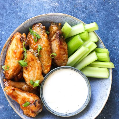 Simple and easy Super Bowl finger food air fryer recipes. Get your friends together for the big game with chicken wings, french fries, sliders, and donuts and make this a football Sunday party to remember. #superbowl #fingerfoods #foodblogger #airfryer #partyfood
