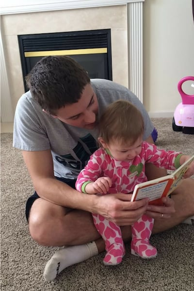 Father Reading to One Year Old