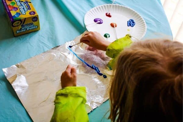 Preschooler doing sensory art