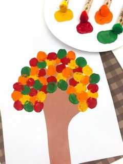 Fall Tree Craft with paints and clothespin pom poms on a paper plate