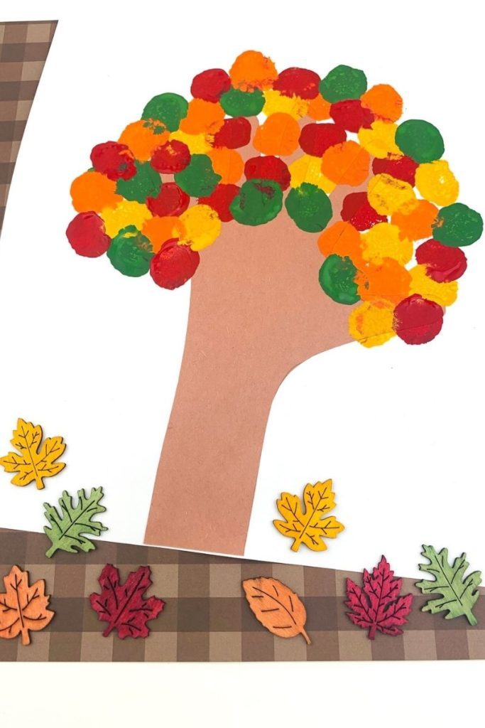 Finished fall tree craft with leaves on the bottom